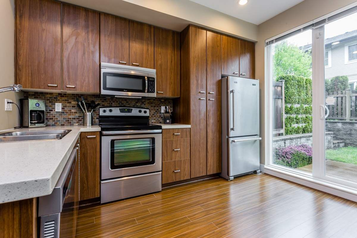 """Main Photo: 201 2450 161A Street in Surrey: Grandview Surrey Townhouse for sale in """"Glenmore at Morgan Heights"""" (South Surrey White Rock)  : MLS®# R2265242"""