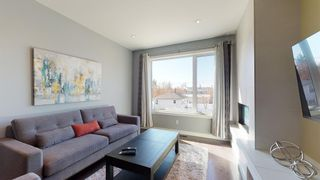 Photo 2: 2910 25 Avenue SW in Calgary: Killarney/Glengarry Row/Townhouse for sale : MLS®# A1085699