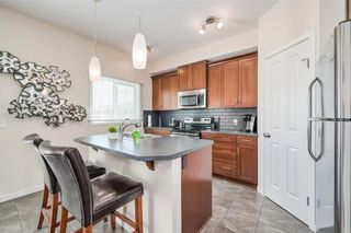 Photo 3: 298 SUNSET Point: Cochrane Row/Townhouse for sale : MLS®# A1033505