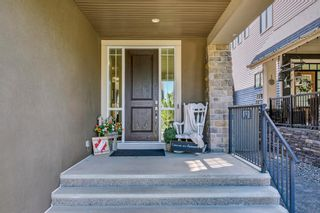 Photo 2: 1241 Coopers Drive SW: Airdrie Detached for sale : MLS®# A1121845