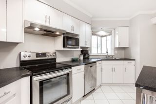 """Photo 10: 1203 PLATEAU Drive in North Vancouver: Pemberton Heights Townhouse for sale in """"Plateau Village"""" : MLS®# R2418766"""