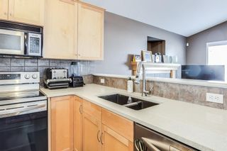 Photo 4: 626 EVERMEADOW Road SW in Calgary: Evergreen Detached for sale : MLS®# A1151420
