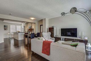 Photo 7: 653 Auburn Bay Boulevard SE in Calgary: Auburn Bay Row/Townhouse for sale : MLS®# A1147022