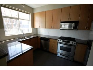 """Photo 3: 104 6878 SOUTHPOINT Drive in Burnaby: South Slope Townhouse for sale in """"CORTINA"""" (Burnaby South)  : MLS®# V878295"""