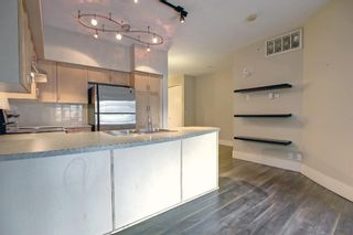 Photo 7: 512 205 Riverfront Avenue SW in Calgary: Chinatown Apartment for sale : MLS®# A1145354