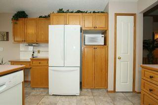 Photo 11: 185 WEST MCDOUGAL Road: Cochrane House for sale : MLS®# C4184033