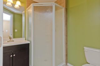 Photo 30: 205 2006 LUXSTONE Boulevard SW: Airdrie Row/Townhouse for sale : MLS®# A1010440