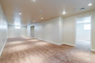 Photo 21: 37 CADOGAN Road NW in Calgary: Cambrian Heights Detached for sale : MLS®# C4294170