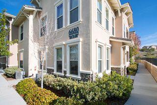 Photo 1: MIRA MESA Condo for sale : 3 bedrooms : 6680 Canopy Ridge Ln #1 in San Diego