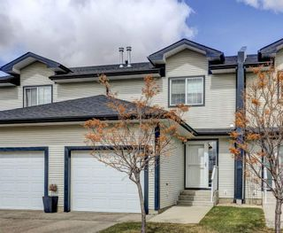 Photo 1: 15 12 Silver Creek Boulevard NW: Airdrie Row/Townhouse for sale : MLS®# A1090078