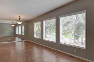 Photo 7: 236 Avonburn Road SE in Calgary: Acadia Semi Detached for sale : MLS®# A1091862