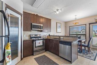 Photo 8: 74 Saddleland Crescent NE in Calgary: Saddle Ridge Detached for sale : MLS®# A1133172