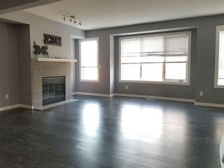 Photo 3: 7 Patina Point SW in Calgary: Patterson Row/Townhouse for sale : MLS®# A1085180
