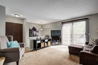 Photo 5: 8347 CENTRE Street NW in Calgary: Beddington Heights House for sale