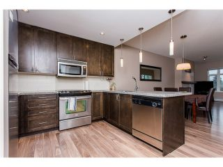 "Photo 1: 403 2368 MARPOLE Avenue in Port Coquitlam: Central Pt Coquitlam Condo for sale in ""RIVER ROCK LANDING"" : MLS®# V1101587"