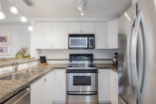 "Photo 1: 9 1073 LYNN VALLEY Road in North Vancouver: Lynn Valley Townhouse for sale in ""River Rock"" : MLS®# R2575517"