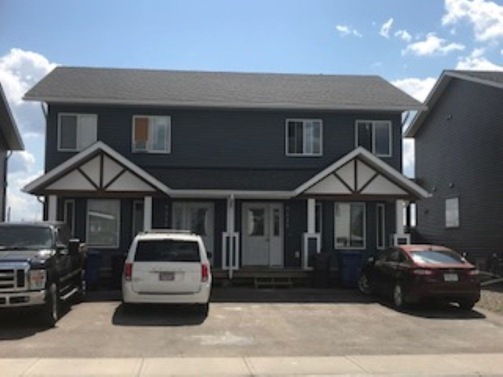 Main Photo: 9211 102 Avenue in Fort St. John: Fort St. John - City NE 1/2 Duplex for sale (Fort St. John (Zone 60))  : MLS®# R2229819