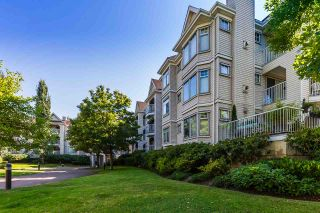 Photo 1: 121 20894 57 Avenue in Langley: Langley City Condo for sale : MLS®# R2302015