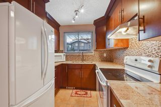 Photo 5: 105 7172 Coach Hill Road SW in Calgary: Coach Hill Row/Townhouse for sale : MLS®# A1053113