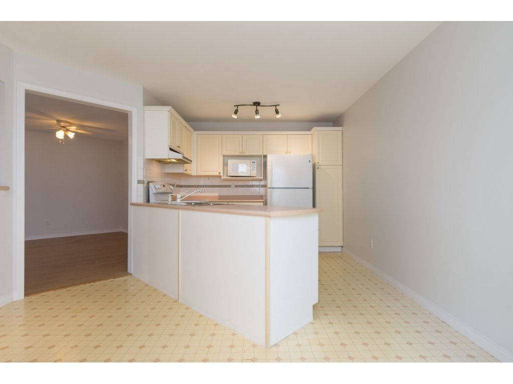 "Photo 9: Photos: 211 12633 72 Avenue in Surrey: West Newton Condo for sale in ""College Park"" : MLS®# R2226813"