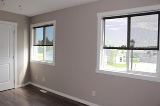 Photo 23: 1404 Clover Link: Carstairs Row/Townhouse for sale : MLS®# A1073804