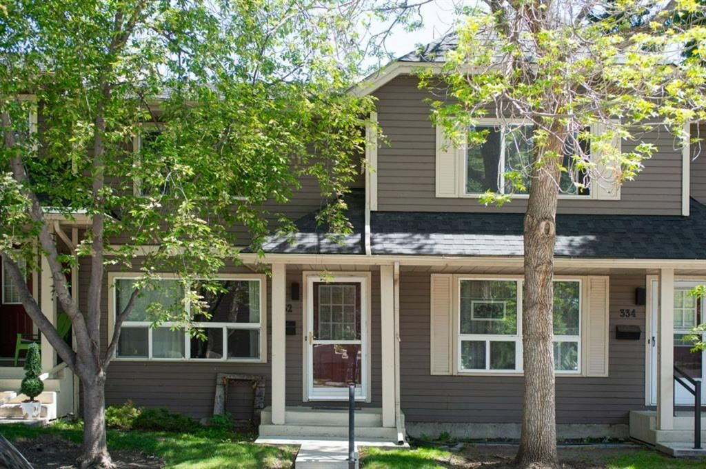 Main Photo: 332 Queenston Heights SE in Calgary: Queensland Row/Townhouse for sale : MLS®# A1114442