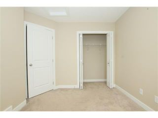 Photo 17: 7 FIRESIDE Parkway: Cochrane House for sale : MLS®# C4068645