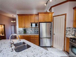 Photo 7: 27 TUSCANY RIDGE Heights NW in Calgary: Tuscany House for sale : MLS®# C4094998