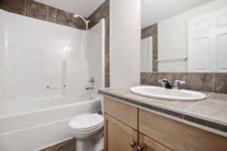 Photo 12: 204 2022 CANYON MEADOWS Drive SE in Calgary: Queensland Apartment for sale : MLS®# A1028195