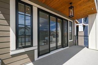 Photo 8: 24 Timberline Way SW in Calgary: Springbank Hill Detached for sale : MLS®# A1120303