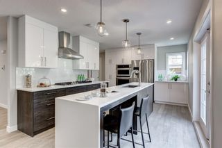 Main Photo: 80 Strathbury Circle SW in Calgary: Strathcona Park Detached for sale : MLS®# A1077668