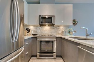 Photo 14: 113 Confluence Mews SE in Calgary: Downtown East Village Row/Townhouse for sale : MLS®# A1138938