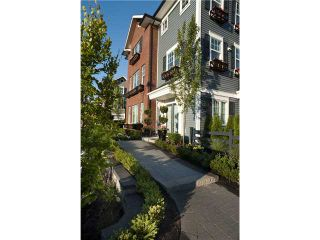 Photo 1: #118 3010 Riverbend Drive in Coquitlam: Coquitlam East Townhouse for sale : MLS®# V863754