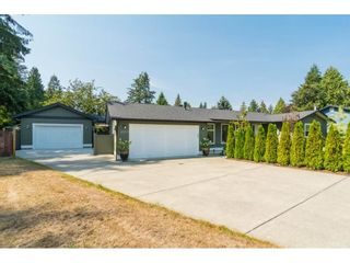 """Photo 2: 4529 207 Street in Langley: Langley City House for sale in """"Mossey/Uplands"""" : MLS®# R2300781"""
