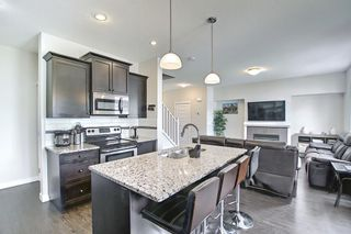 Photo 4: 3803 1001 8 Street: Airdrie Row/Townhouse for sale : MLS®# A1105310