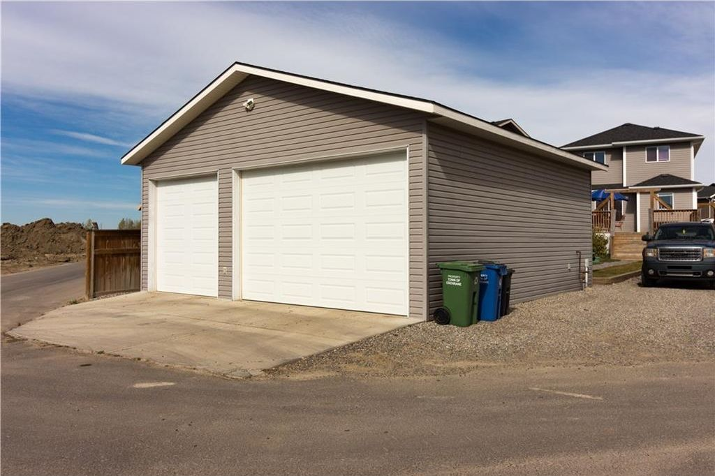 Over-sized Triple car garage 30'x30', 10ft doors with a R20 rating. Best quality door available; Lift Master 3000 with Dead Bolt Lock. Security System