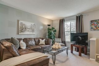 Photo 3: 56 Elgin Gardens SE in Calgary: McKenzie Towne Row/Townhouse for sale : MLS®# A1009834