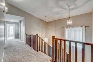 Photo 18: 85 Cougar Ridge Close SW in Calgary: Cougar Ridge Detached for sale : MLS®# A1128029