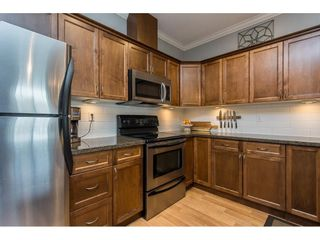 """Photo 4: 401 33338 MAYFAIR Avenue in Abbotsford: Central Abbotsford Condo for sale in """"THE STERLING"""" : MLS®# R2617623"""