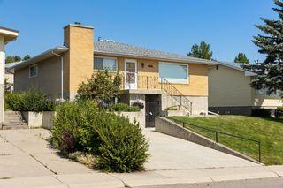 Photo 2: 7420 Hunterburn Hill NW in Calgary: Huntington Hills Detached for sale : MLS®# A1123049
