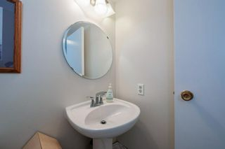 Photo 25: 332 Queenston Heights SE in Calgary: Queensland Row/Townhouse for sale : MLS®# A1114442