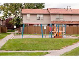 Photo 18: 94 123 QUEENSLAND Drive SE in Calgary: Queensland House for sale : MLS®# C4027673