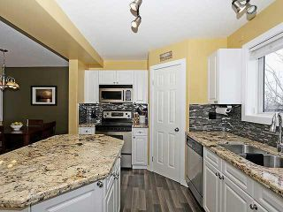 Photo 8: 310 COVENTRY Road NE in Calgary: Coventry Hills House for sale : MLS®# C3655004