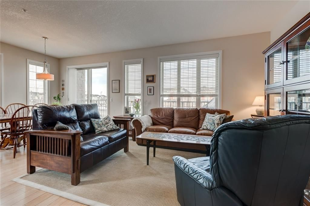 Main Photo: 2102 15 SUNSET Square: Cochrane Condo for sale : MLS®# C4172939