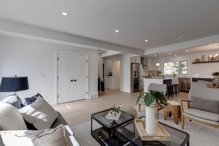 Photo 6: 128 Thorncrest Road NW in Calgary: Thorncliffe Detached for sale : MLS®# A1146759