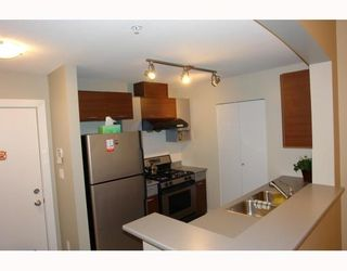 """Photo 4: 102 9233 FERNDALE Road in Richmond: McLennan North Condo for sale in """"RED II"""" : MLS®# V812338"""