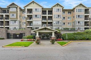 "Photo 1: 214 19673 MEADOW GARDENS Way in Pitt Meadows: North Meadows PI Condo for sale in ""THE FAIRWAYS"" : MLS®# R2566275"