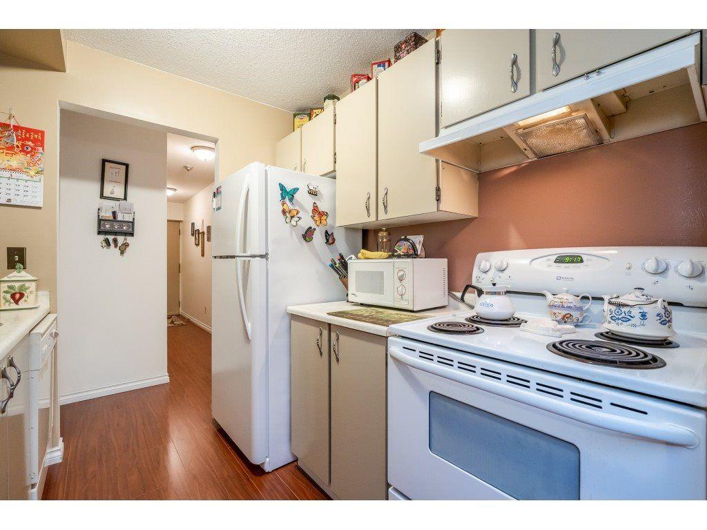 "Photo 5: Photos: 205 7155 134 Street in Surrey: West Newton Condo for sale in ""EAGLE GLEN"" : MLS®# R2446715"