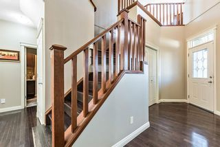 Photo 4: 157 Springbluff Boulevard SW in Calgary: Springbank Hill Detached for sale : MLS®# A1129724