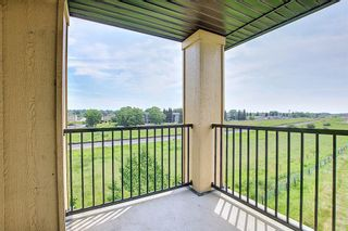 Photo 35: 6413 304 Mackenzie Way SW: Airdrie Apartment for sale : MLS®# A1128019